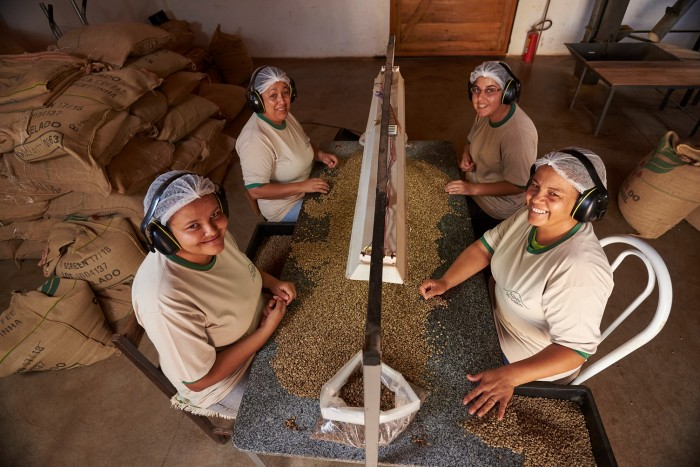 Women processing coffee on UTZ certified farm in Brazil