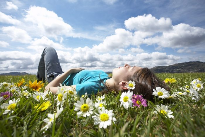 Girl resting in a meadow