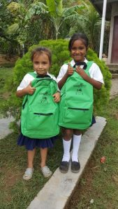 Girls with COAGRICSAL school bags